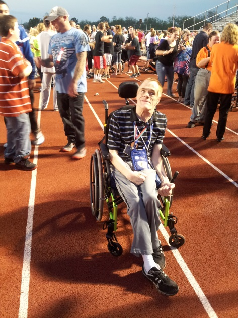 Man in Wheelchair on Running Track